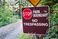 Stop; Park boundary; No Trespassing sign posted in Santa Cruz Mountains; California