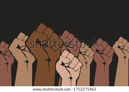 Stop racism. Many multi colored fist protesting on dark background. Black lives matter. Different races hands protest, interracial community unity. New movement