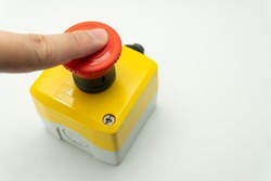 Stop Red Button and the Hand of Worker About to Press it. emergency stop button. Big Red emergency button or stop button for manual pressing.