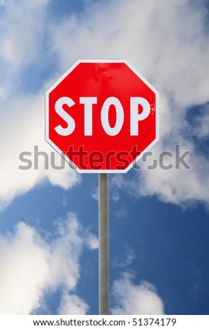 Stop road sign on cloudy sky