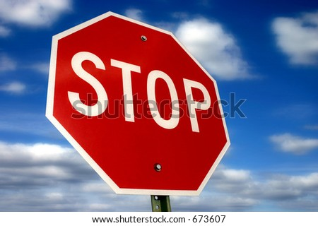 Stop sign against a beautiful sky