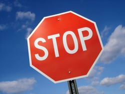 Stop sign against a blue sky.
