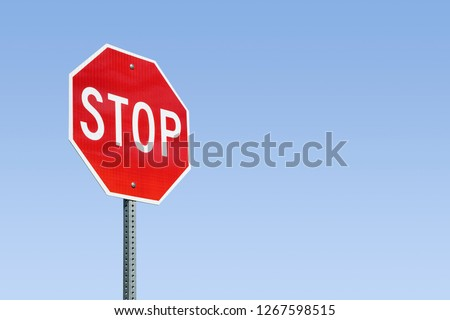 Stop Sign And Blue Sky #1267598515