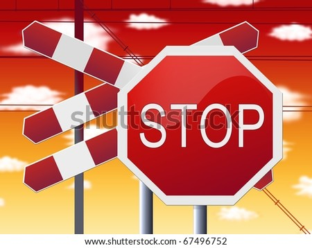 stop sign at railway crossing and red sky