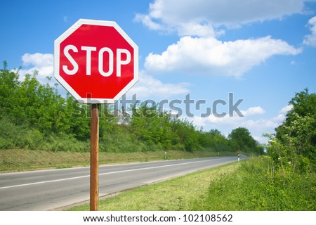 Stop sign by the empty road