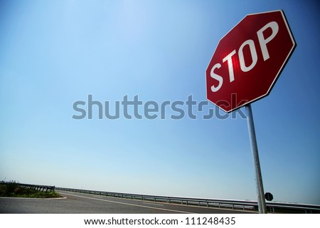 Stop sign by the side of the road
