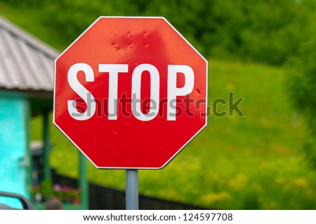 Stop sign closeup photo with nature in background