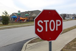 Stop sign in front of school playground