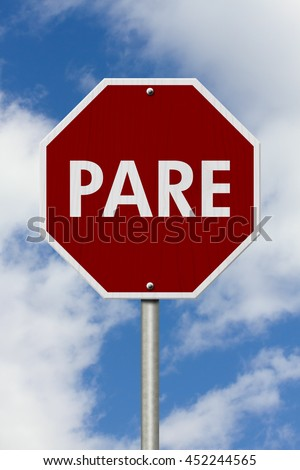 Shutterstock Stop Sign in Spanish Pare Sign, Red and white Stop Sign with word Pare with sky background, 3D Illustration