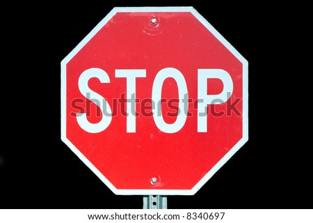 Stop sign isolated on a black background.