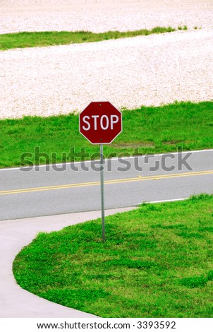 Stop sign on a local road with copyspace at the top