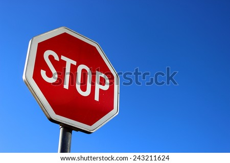 Stop sign on blue sky