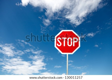 Stop sign on the blue sky - stock photo