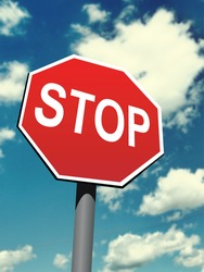 stop sign on the blurred sky background