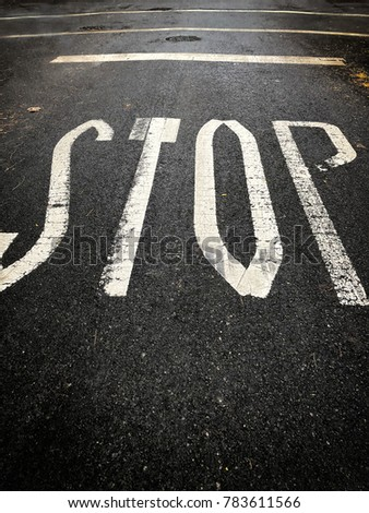 Stop sign painted on ground #783611566