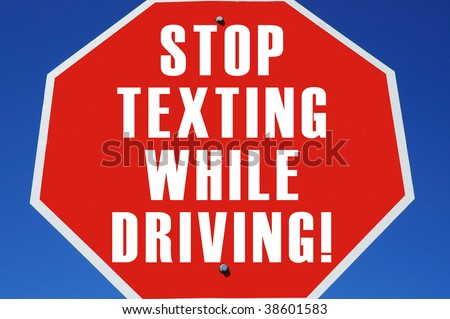 "stop sign reading ""Stop texting while driving"""