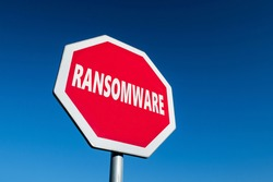 Stop sign with a text RANSOMWARE to cease malware attacks and protect against them