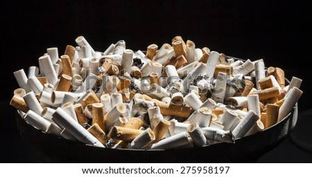 Stop smoking - ashtray full of cigarette ends