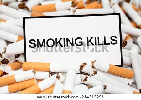 Stop Smoking! Broken cigarettes and warning message \