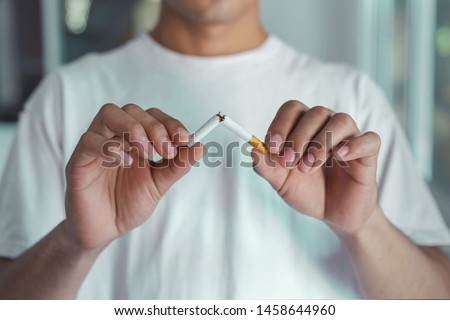 Stop smoking cigarettes concept. Portrait of beautiful  holding broken cigarette in hands. Happy , health care concept. No smoking.