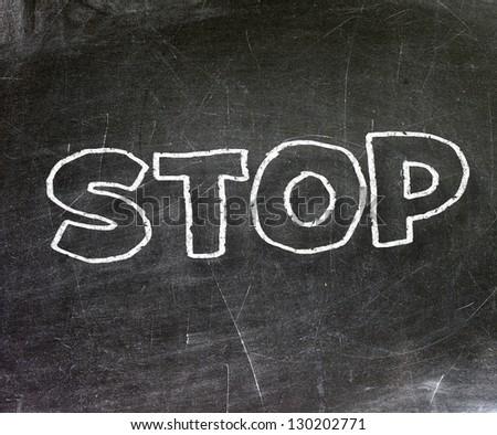 STOP title written with chalk on a blackboard
