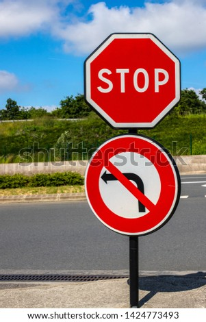 Stop traffic sign no left turn. Traffic restriction Against the background of the road and the bright sky