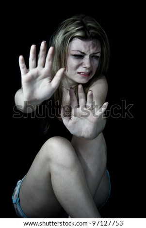 "STOP Violence With Women, Scared and beaten white woman holding out her hands in the ""STOP"" position"