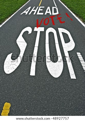 stock-photo-stop-vote-ahead-sign-on-the-road-pavement-48927757.jpg