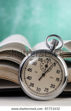 stop watch in front of the book