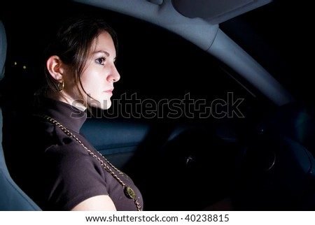 Stopped car with beautiful woman inside