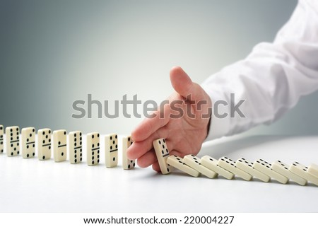Stopping the domino effect concept for business solution, strategy and successful intervention