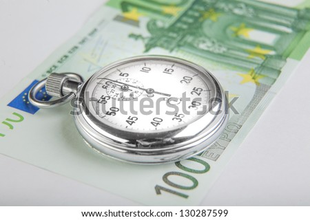 Stopwatch and a hundred euro banknote.  Closeup - stock photo