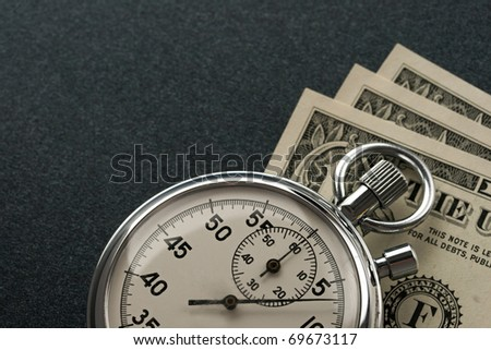 Stopwatch and dollar