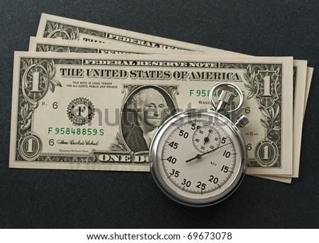 Stopwatch and dollars - stock photo