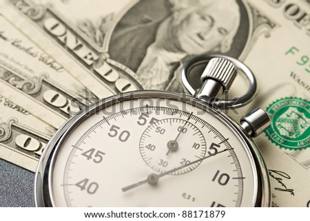 Stopwatch and dollars