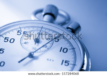 Stopwatch closeup in blue toning
