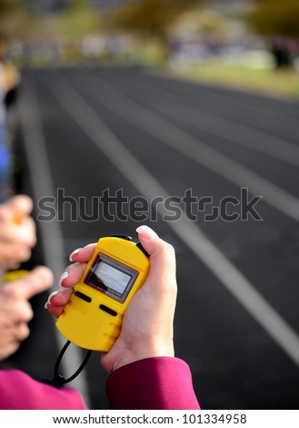 Stopwatch for running a race around a track with  lines