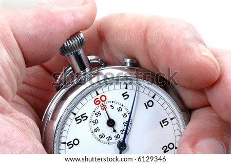 Stopwatch in a hand counting the time