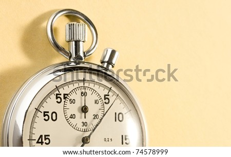 Stopwatch isolated on yellow
