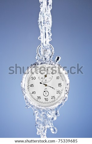Stopwatch surrounded by a stream of water on a blue background. Metaphor of flowing away time.