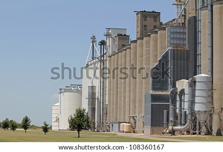 Storage and grain processing facilities on secondary roads of farm and agricultural lands of Arkansas.