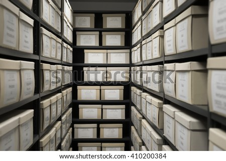 Storage archive depository black shelves with white office boxes card file lab cabinet evidence.