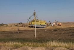 Storage area for decommissioned excavators in a clay quarry. Zaporozhye region, Ukraine. November 2017