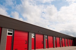 storage building with red  numbered doors