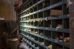 Storage cubby with shoes and labels in turn of the century silk throwing factory.