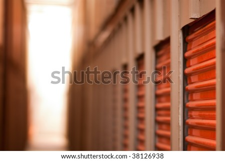 Storage Doors - Row of storage unit doors shallow depth of focus. Safe storage when moving or relocating.