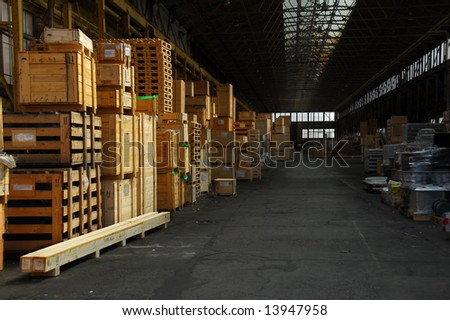 Storage hall with wooden crates packed with industry items. - stock photo