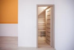 Storage idea for attic bedroom closet in home