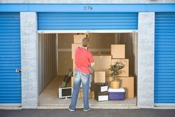 Storage: Man Finished Putting Stuff In Storage