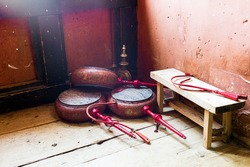 Storage of Ceremonial drum in temple of Bhutan : This double-headed frame drum, played with a crooked beater and supported by handle. China, Tibet, big drums are used during the ceremonies.